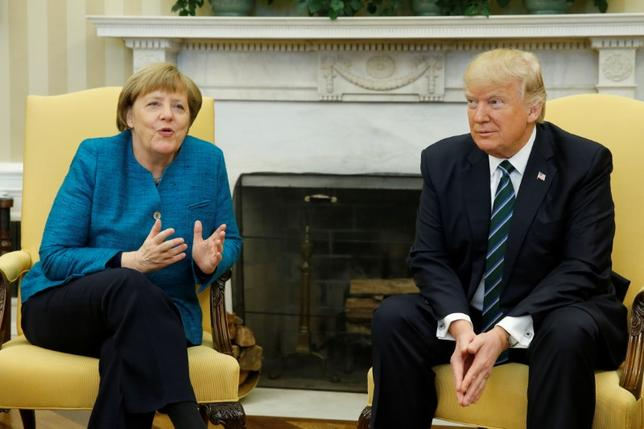 FILE PHOTO: U.S. President Donald Trump meets with Germany's Chancellor Angela Merkel in the Oval Office at the White House in Washington, U.S. March 17, 2017. REUTERS/Jonathan Ernst
