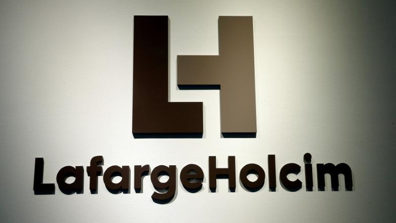 FILE PHOTO: The logo of LafargeHolcim is seen at its headquarters in Zurich, Switzerland, March 2, 2017.  REUTERS/Arnd Wiegmann/File Photo