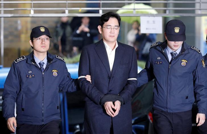 FILE PHOTO - Samsung Group chief, Jay Y. Lee arrives at the office of the independent counsel team in Seoul, South Korea, February 22, 2017. REUTERS/Kim Hong-Ji