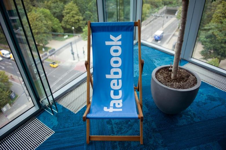 FILE PHOTO: A picture shows the Facebook logo on a beach chair at the Facebook office in Berlin, Germany, August 29, 2016. REUTERS/Stefanie Loos