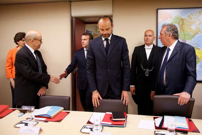 French President Emmanuel Macron (2ndL) greets Foreign Minister Jean-Yves Le Drian as he arrives to attend the weekly Defense Council with Prime Minister Edouard Philippe (C) and Justice Minister Francois Bayrou (R) in the Jupiter room at the Elysee Palace in Paris, France, May 31, 2017. REUTERS/Charles Platiau