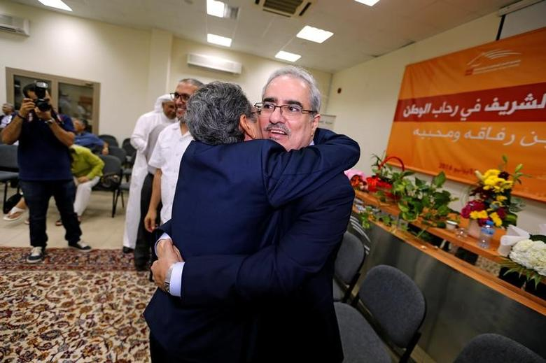 Head of National Democratic Action Society (WAAD), a secular party, Ebrahim Shareef (L) is greeted by a well-wisher after his release from prison after completing one year sentence, at party's headquarters in Manama, Bahrain July 12, 2016. REUTERS/Hamad I Mohammed/Files