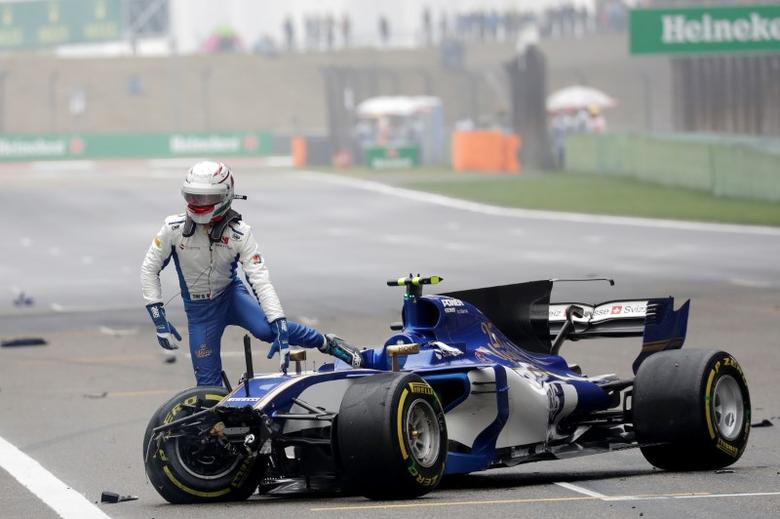 Italian driver Antonio Giovinazzi prepares to get off his Sauber after he crashed during the Chinese Formula One Grand Prix at the Shanghai International Circuit in Shanghai, China, Sunday, April 9, 2017. REUTERS/Andy Wong/Pool