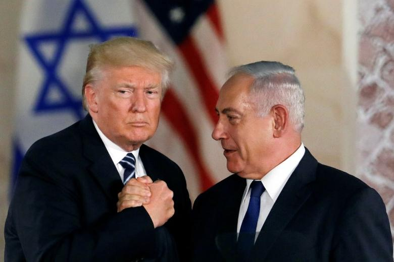FILE PHOTO: U.S. President Donald Trump and Israeli Prime Minister Benjamin Netanyahu shake hands after Trump's address at the Israel Museum in Jerusalem May 23, 2017. REUTERS/Ronen Zvulun