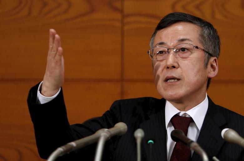 Bank of Japan (BOJ) board member Yutaka Harada points at a reporter during news conference at the BOJ headquarters in Tokyo March 26, 2015.  REUTERS/Yuya Shino