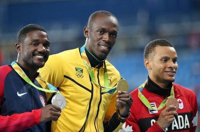 5月31日、陸上短距離の五輪銀メダリスト、ジャスティン・ガトリン(左)は、全米選手権の男子100メートル優勝に向けて意気込みを示した。リオデジャネイロで2016年8月撮影(2017年 ロイター/Sergio Moraes)