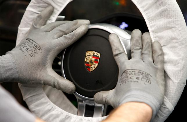 FILE PHOTO: A worker assembles a steering wheel of a new Porsche 911 sports car at the Porsche factory in Stuttgart-Zuffenhausen, Germany, March 10, 2015.  REUTERS/Michaela Rehle/File Photo