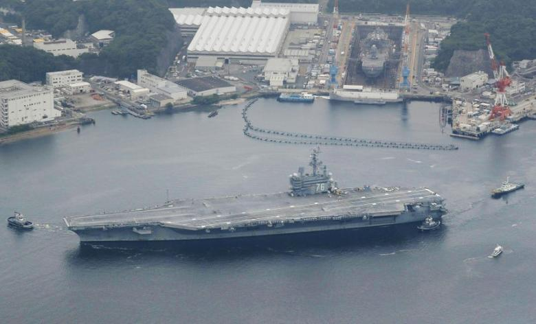 USS Ronald Reagan, a Nimitz-class nuclear-powered supercarrier, leaves from its home port to be deployed in waters near Japan, in Yokosuka, south of Tokyo, Japan, in this photo taken by Kyodo May 16, 2017. Mandatory credit Kyodo/via REUTERS