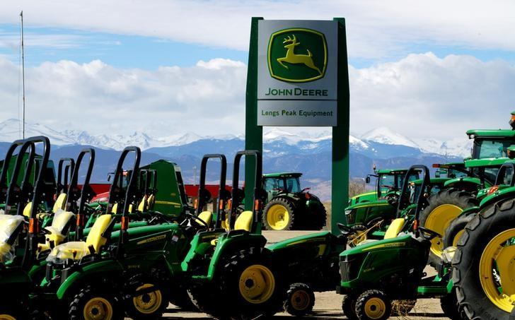John Deere tractors are seen for sale at a dealer in Longmont, Colorado, U.S., February 21, 2017. REUTERS/Rick Wilking