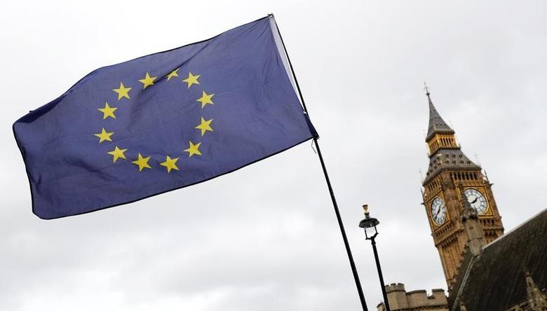 FILE PHOTO - A European Union flag is waved in front of Big Ben outside Parliament after Britain's Prime Minister Theresa May triggered the process by which the United Kingdom will leave the European Union in London, March 28, 2017. REUTERS/Stefan Wermuth