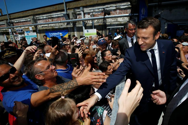 French President Emmanuel Macron (R) visits the harbour of Lorient, France, June 1, 2017. REUTERS/Stephane Mahe