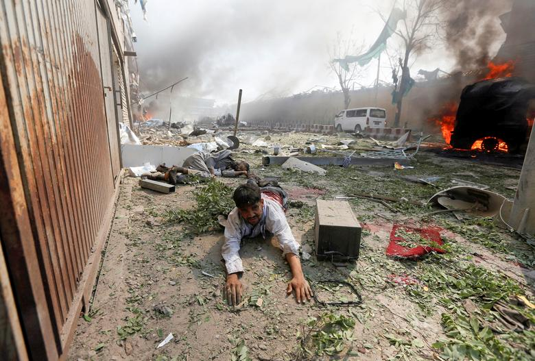 A wounded man lies on the ground at the site of a blast in Kabul, Afghanistan, May 31, 2017. REUTERS/Omar Sobhani/ File Photo