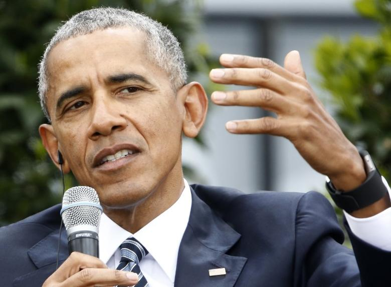 FILE PHOTO: Former U.S. President Barack Obama speaks during a discussion at the German Protestant Kirchentag in front of the Brandenburg Gate in Berlin, Germany, May 25, 2017. REUTERS/Fabrizio Bensch
