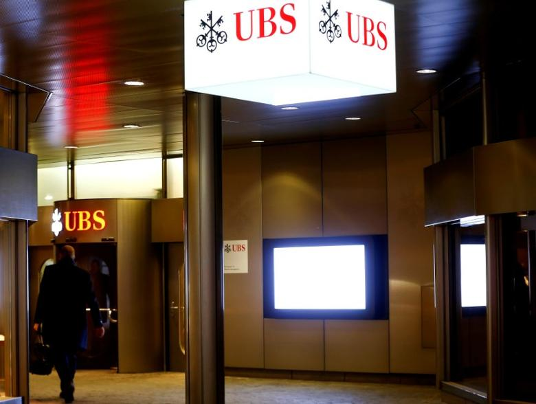 Logos of Swiss bank UBS are seen at a branch office in Zurich, Switzerland January 27, 2017. REUTERS/Arnd Wiegmann