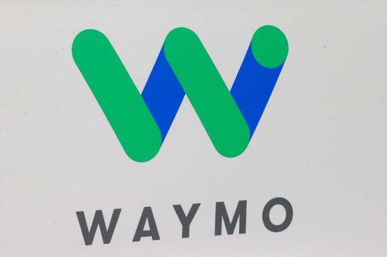 FILE PHOTO - The Waymo logo is displayed during the company's unveil of a self-driving Chrysler Pacifica minivan during the North American International Auto Show in Detroit, Michigan, U.S., January 8, 2017.  REUTERS/Brendan McDermid/File Photo