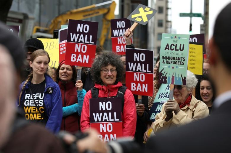 People protest U.S. President Donald Trump's travel ban outside of the U.S. Court of Appeals in Seattle, Washington, U.S. May 15, 2017.  REUTERS/David Ryder