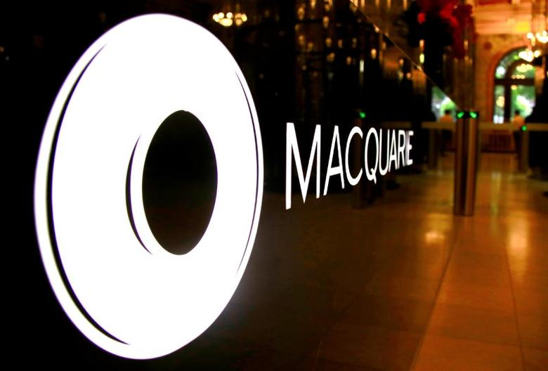FILE PHOTO: The logo of Australia's biggest investment bank Macquarie Group Ltd adorns a desk in the reception area of their Sydney office headquarters in Australia, October 28, 2016.    REUTERS/David Gray/File Photo