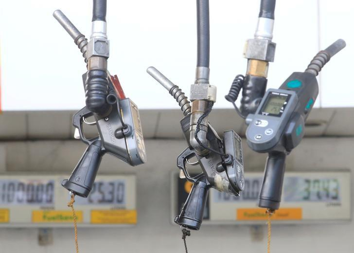 FILE PHOTO: Fuel pumps hang at a gasoline station in Metro Manila, Philippines, August 4, 2016. REUTERS/Romeo Ranoco/File Photo
