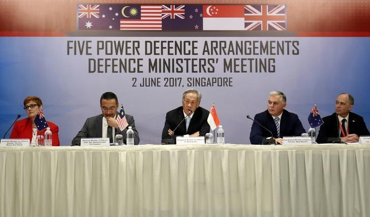 (L-R) Australia's Minister for Defence Marise Ann Payne, Malaysia's Minister of Defence Dato' Seri Hishammuddin Tun Hussein, Singapore's Minister for Defence Ng Eng Hen, New Zealand's Minister of Defence Mark Mitchell and Britain's High Commissioner to Singapore Scott Wightman attend the Five Power Defence Arrangements Defence Ministers' Meeting in Singapore June 2, 2017. REUTERS/Yong Teck Lim