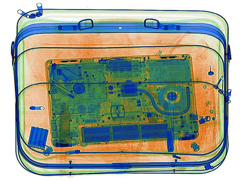 An illustration picture shows a laptop on the screen of an X-ray security scanner, April 7, 2017. Picture taken April 7, 2017.    REUTERS/Srdjan Zivulovic/Illustration