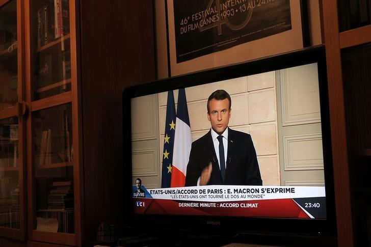 French President Emmanuel Macron, seen on all news channel LCI, speaks from the Elysee Palace in Paris, France, after U.S. President Donald Trump announced his decision that the United States will withdraw from the Paris Climate Agreement at a news conference, June 1, 2017. REUTERS/John Schults