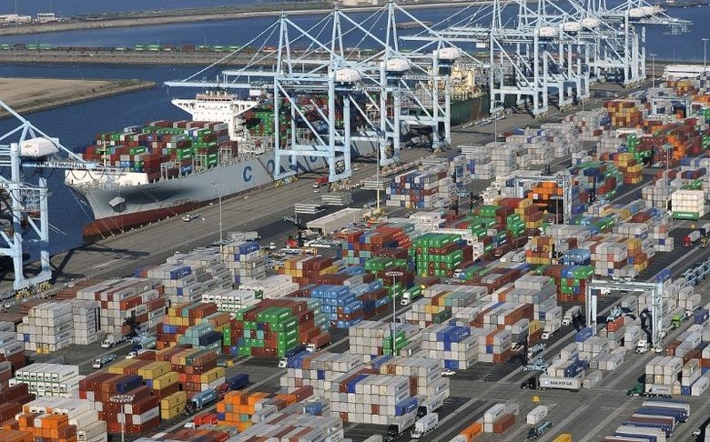 Shipping containers sit idle at the ports of Los Angeles and Long Beach, California in this aerial photo taken February 6, 2015. REUTERS/Bob Riha, Jr.