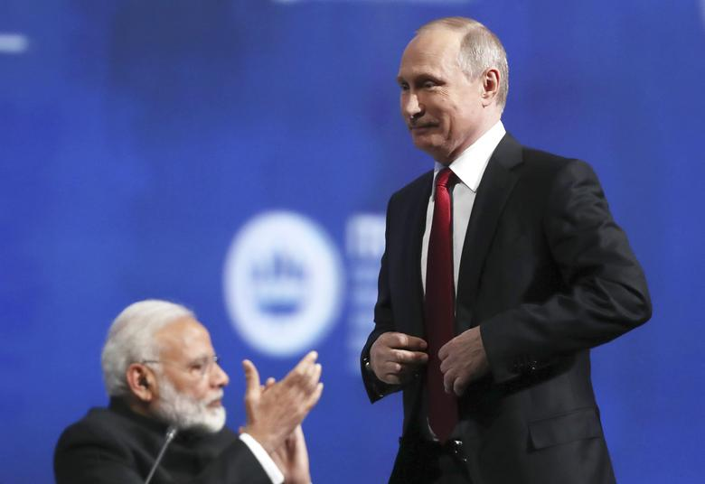 Russian President Vladimir Putin (R) and Indian Prime Minister Narendra Modi attend a session of the St. Petersburg International Economic Forum (SPIEF), Russia, June 2, 2017. REUTERS/Stanislav Krasilnikov/TASS/Host Photo Agency/Pool
