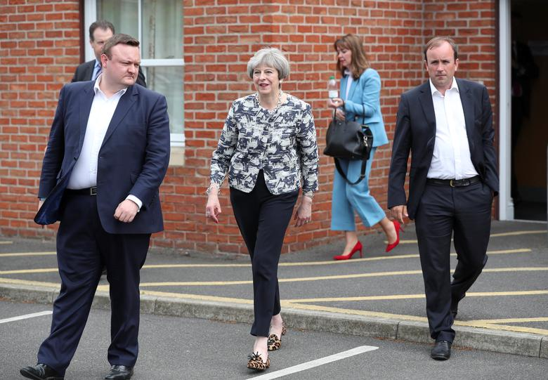 Britain's Prime Minister Theresa May walks during a campaign stop near Doncaster, Britain June 2, 2017. REUTERS/Scott Heppell