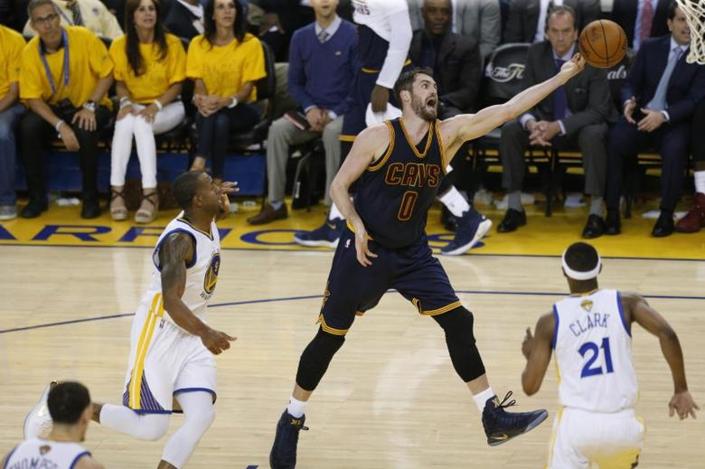 Jun 1, 2017; Oakland, CA, USA; Cleveland Cavaliers forward Kevin Love (0) reaches for the ball against the Golden State Warriors in the first half of the NBA Finals at Oracle Arena. Mandatory Credit: Cary Edmondson-USA TODAY Sports