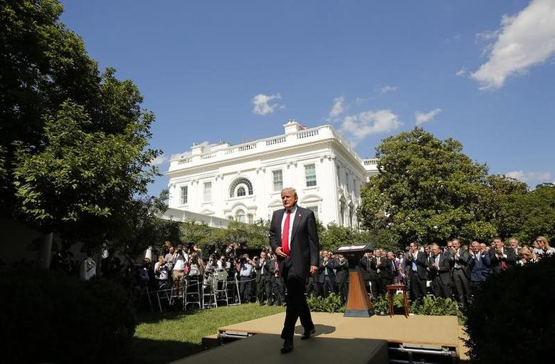 U.S. President Donald Trump departs after announcing his decision that the United States will withdraw from the landmark Paris Climate Agreement, in the Rose Garden of the White House in Washington, U.S., June 1, 2017. REUTERS/Kevin Lamarque