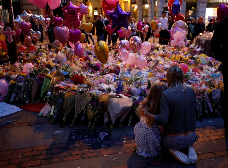 People attend a vigil for the victims of last week's attack at a pop concert at Manchester Arena, in central Manchester, Britain. REUTERS/Andrew Yates