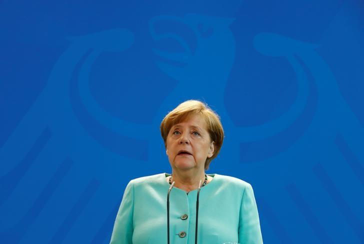 German Chancellor Angela Merkel delivers a statement about Trump's global climate deal announcement at the Chancellory in Berlin, Germany, June 2, 2017.    REUTERS/Fabrizio Bensch/Files