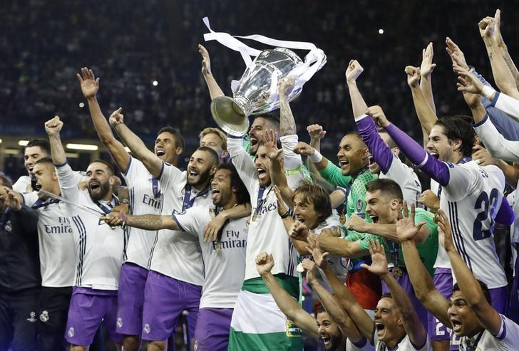 Britain Soccer Football - Juventus v Real Madrid - UEFA Champions League Final - The National Stadium of Wales, Cardiff - June 3, 2017 Real Madrid's Sergio Ramos celebrates with the trophy after winning the UEFA Champions League Final  Reuters / Carl Recine Livepic
