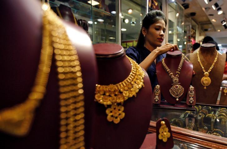 A salesperson attends to a customer (not pictured) inside a jewellery showroom, during Akshaya Tritiya, a major gold-buying festival, in Mumbai, India April 28, 2017. REUTERS/Shailesh Andrade/Files