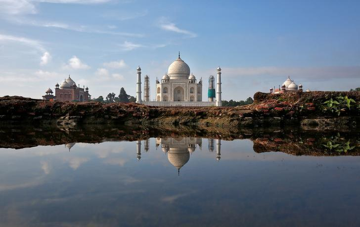 The Taj Mahal is reflected in a puddle in Agra, August 9, 2016. REUTERS/Cathal McNaughton
