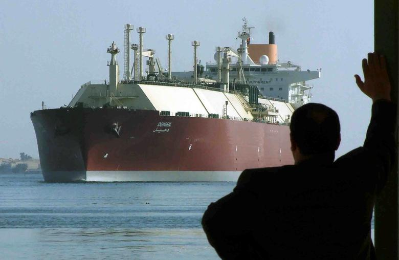 A man looks as the world's biggest Liquefied Natural Gas (LNG) tanker, Qatari-flagged DUHAIL as she crosses through the Suez Canal April 1, 2008. Stringer