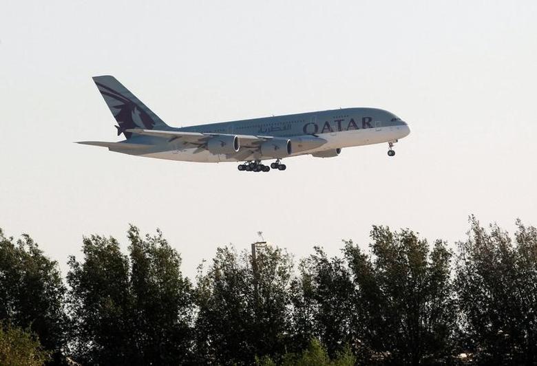 A Qatar Airways plane is seen over Doha, Qatar June 5, 2017. REUTERS/Stringer