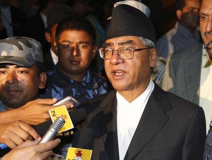 FILE PHOTO: Sher Bahadur Deuba talks to the media after being defeated by Maoist leader Prachanda at the Constituent Assembly in Kathmandu August 15, 2008. REUTERS/Gopal Chitrakar/Files