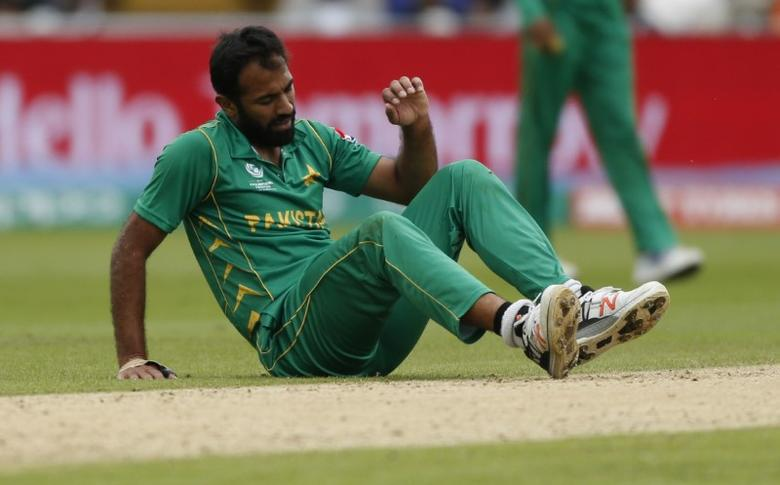 Britain Cricket - India v Pakistan - 2017 ICC Champions Trophy Group B - Edgbaston - June 4, 2017 Pakistan's Wahab Riaz lies injured Action Images via Reuters / Andrew Boyers Livepic