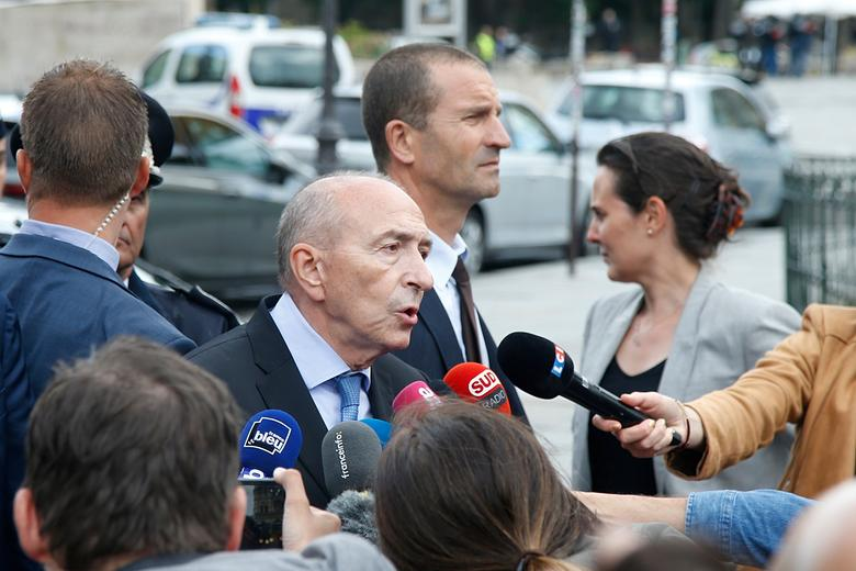 French Interior Minister Gerard Collomb talks to journalists at the scene of a shooting incident near the Notre Dame Cathedral in Paris, France, June 6, 2017.  REUTERS/Charles Platiau