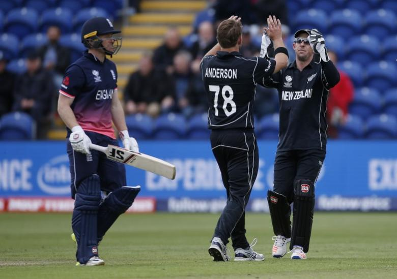 Britain Cricket - England v New Zealand - 2017 ICC Champions Trophy Group A - Sophia Gardens, Wales - June 6, 2017 New Zealand's Luke Ronchi and Corey Anderson celebrate the wicket of England's Eoin Morgan  Action Images via Reuters / Paul Childs Livepic