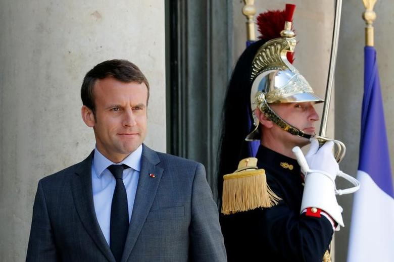 French President Emmanuel Macron waits for guests to leave at the Elysee Palace in Paris, France, June 6, 2017.  REUTERS/Philippe Wojazer
