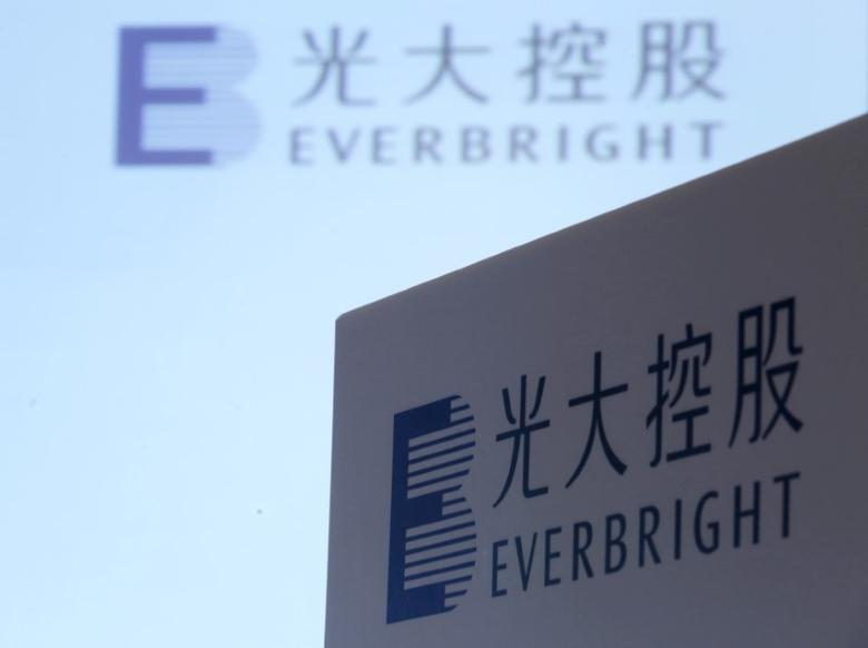 FILE PHOTO: The company logos of China Everbright Limited are displayed at a news conference on the company's annual results in Hong Kong, China March 23, 2016.      REUTERS/Bobby Yip/File Photo