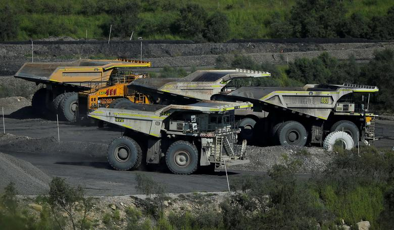 FILE PHOTO: A coal truck passes others inside coal giant Rio Tinto's Hunter Valley operations in Lemington, north of Sydney, Australia, April 9, 2017.  REUTERS/Jason Reed/File Photo