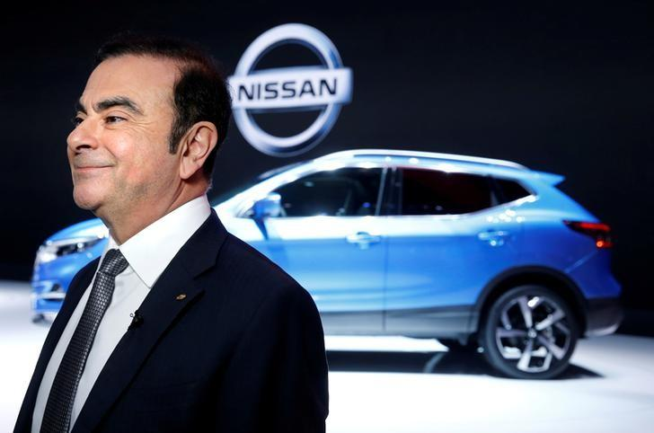 FILE PHOTO: Carlos Ghosn, Chairman and CEO of the Renault-Nissan Alliance, smiles before an interview during the 87th International Motor Show at Palexpo in Geneva, Switzerland, March 7, 2017. REUTERS/Denis Balibouse/File Photo