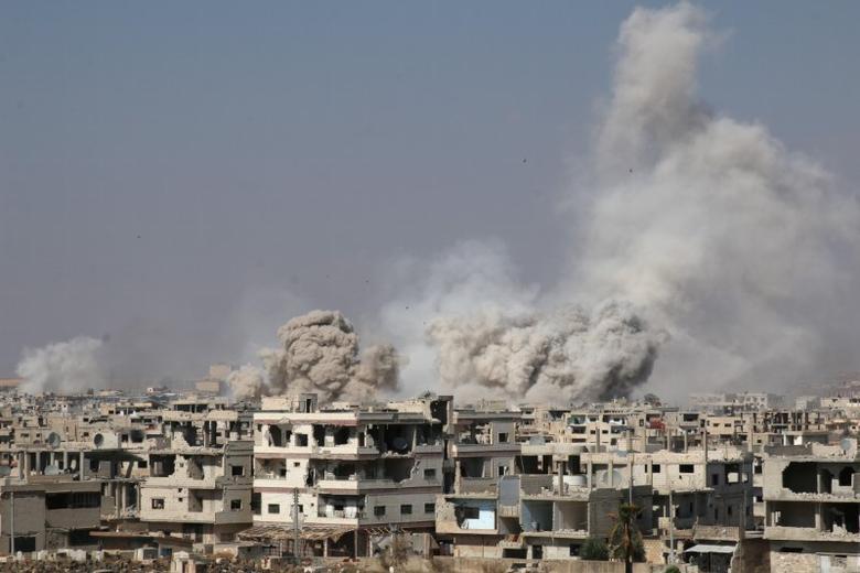 Smoke rises after shelling on a rebel-held area of Deraa, Syria, June 4, 2017. REUTERS/Alaa Al-Faqir