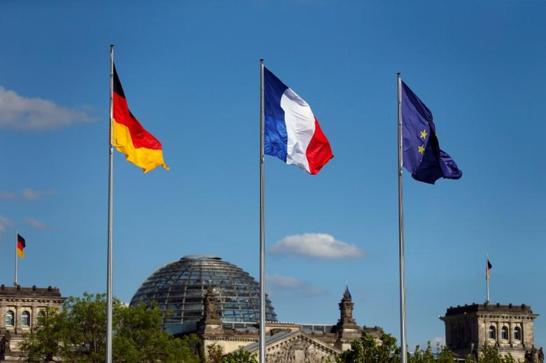 FILE PHOTO - The flags of Germany, France and the European Union are seen in front of the the Chancellery, before the meeting between German Chancellor Angela Merkel and French President Emmanuel Macron in Berlin, Germany May 15, 2017. REUTERS/Hannibal Hanschke