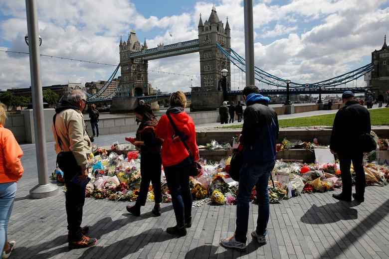 Floral tributes are seen near the scene of the recent attack at London Bridge and Borough Market in central London, Britain June 7, 2017. REUTERS/Stefan Wermuth