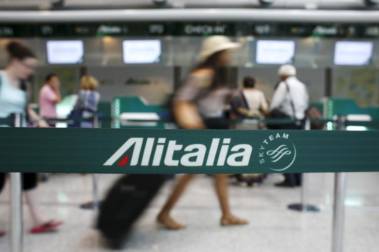 People walk in the Alitalia departure hall during a strike by Italy's national airline Alitalia workers at Fiumicino international airport in Rome, Italy July 24, 2015. REUTERS/Max Rossi