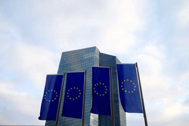 FILE PHOTO: European Union (EU) flags fly in front of the European Central Bank (ECB) headquarters in Frankfurt, Germany, December 3, 2015. REUTERS/Ralph Orlowski/File Photo